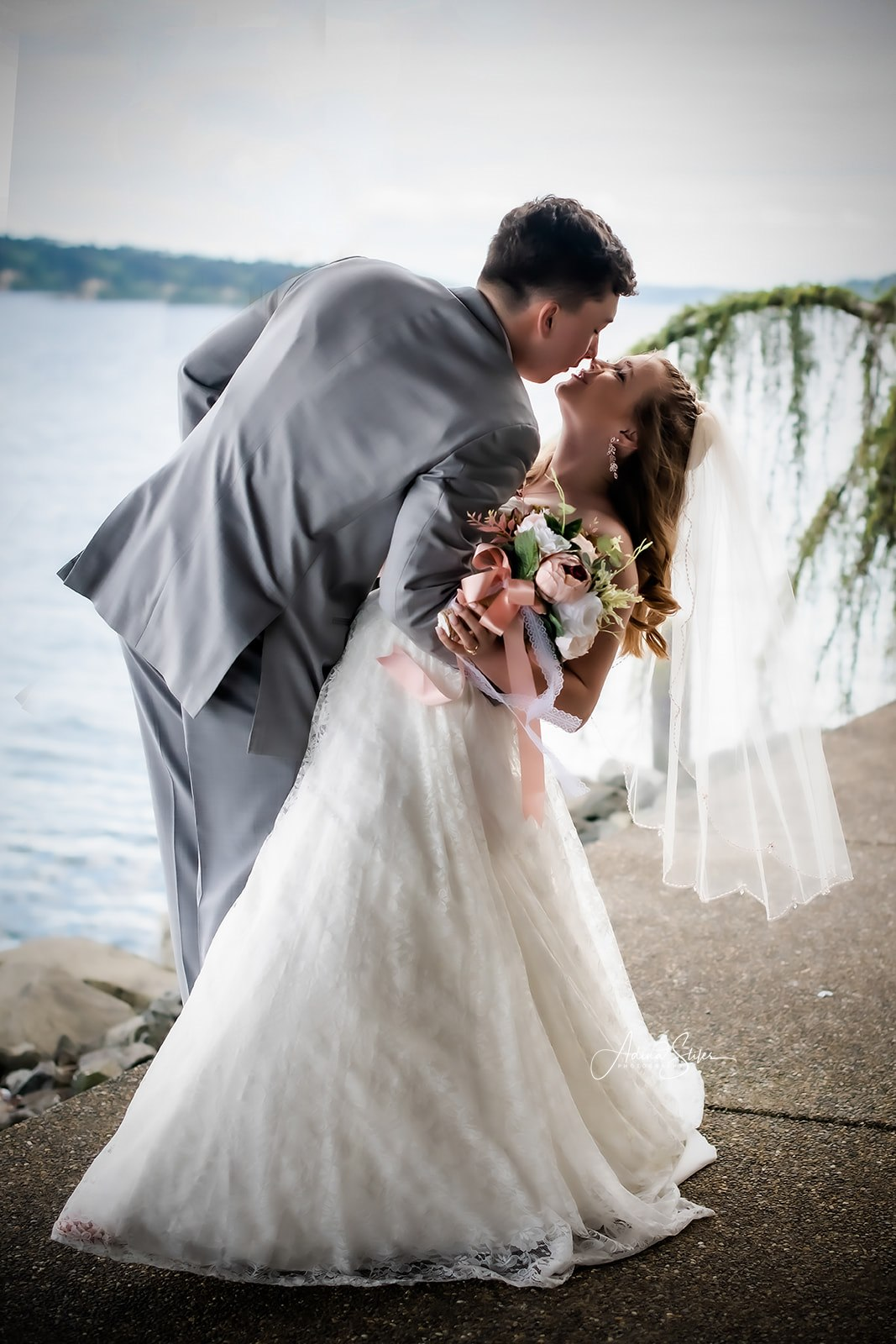 A groom dips his bride by the water during a last-minute wedding celebration in Puget Sound, Washington.