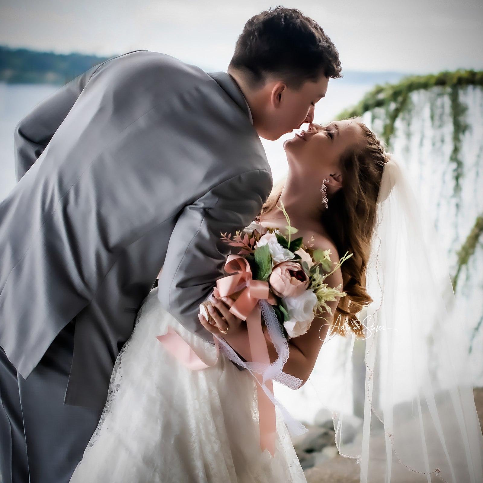 A bride and groom kiss at their last-minute wedding in Olalla, Washington.